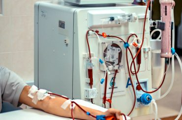 A patient having his blood cleaned via the dialysis machine.